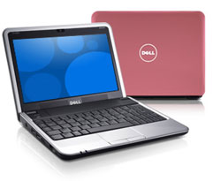 A photo of a pink Dell Mini 9 netbook computer